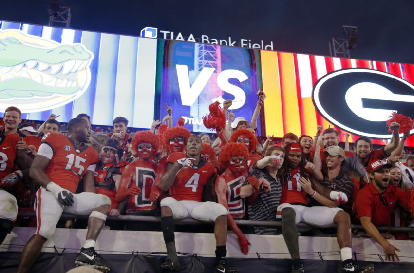 Georgia Bulldogs wide receiver Mecole Hardman (4) celebrates with teammates and fans after defeating the Florida Gators at TIAA Bank Field. Mandatory Credit: Kim Klement-USA TODAY Sports