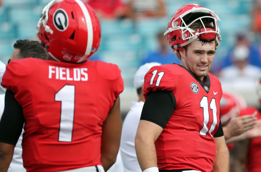 Georgia Bulldogs quarterback Jake Fromm (11) and quarterback Justin Fields (1) - Mandatory Credit: Kim Klement-USA TODAY Sports
