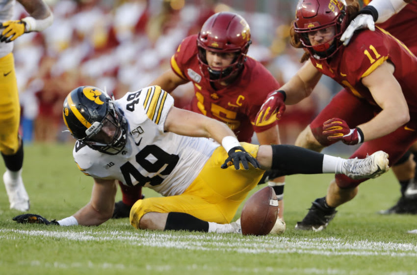 AMES, IA - SEPTEMBER 14: Linebacker Nick Niemann #49 of the Iowa Hawkeyes, quarterback Brock Purdy #15, and tight end Chase Allen #11 of the Iowa State Cyclones all attempt to recover a fumble made by Purdy in the first half of play at Jack Trice Stadium on September 14, 2019 in Ames, Iowa. (Photo by David Purdy/Getty Images)