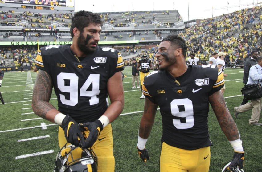 IOWA CITY, IOWA- OCTOBER 19: Defensive end A.J. Epenesa #94 and defensive back Geno Stone #9 of the Iowa Hawkeyes walk off the field together following their match-up against the Purdue Boilermakers on October 19, 2019 at Kinnick Stadium in Iowa City, Iowa. (Photo by Matthew Holst/Getty Images)