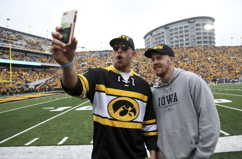 IOWA CITY, IOWA- SEPTEMBER 28: Tight end George Kittle and quarterback C.J. Beathard of the San Francisco 49ers take photos on the field during the match-up between their alma mater Iowa Hawkeyes and the Middle Tennessee Blue Raiders on September 28, 2019 at Kinnick Stadium in Iowa City, Iowa. (Photo by Matthew Holst/Getty Images)