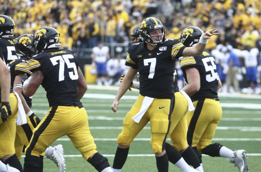 IOWA CITY, IOWA- SEPTEMBER 28: Quarterback Spencer Petras #7 of the Iowa Hawkeyes celebrates a touchdown during the second half against the Middle Tennessee Blue Raiders on September 28, 2019 at Kinnick Stadium in Iowa City, Iowa. (Photo by Matthew Holst/Getty Images)