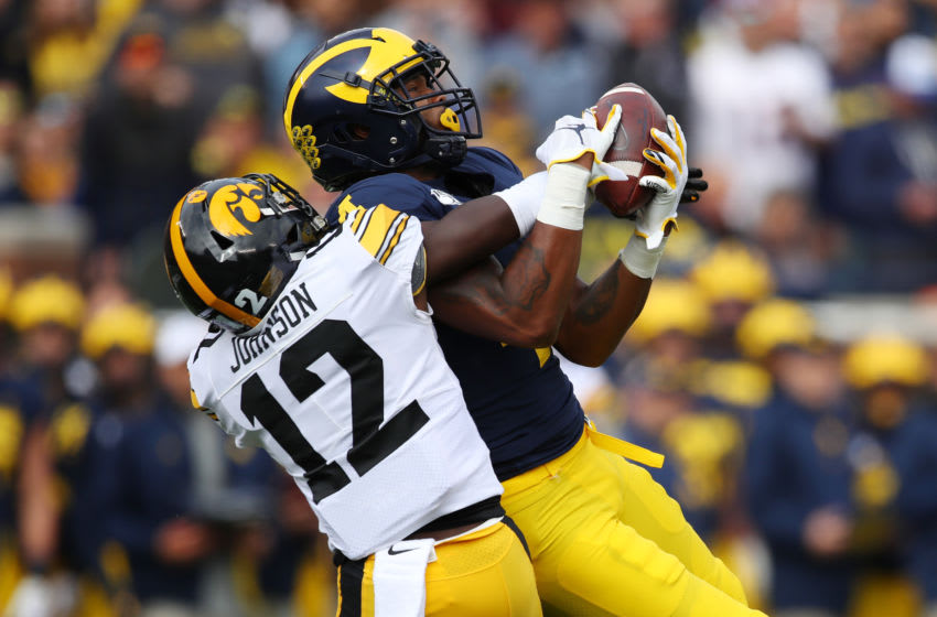 ANN ARBOR, MICHIGAN - OCTOBER 05: Nico Collins #4 of the Michigan Wolverines makes a first quarter catch against D.J. Johnson #12 of the Iowa Hawkeyes at Michigan Stadium on October 05, 2019 in Ann Arbor, Michigan. (Photo by Gregory Shamus/Getty Images)