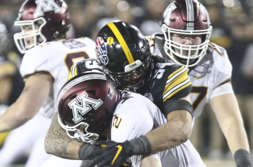 IOWA CITY, IOWA- NOVEMBER 16: Defensive end A.J. Epenesa #94 of the Iowa Hawkeyes makes a sack during the second half on quarterback Tanner Morgan #2 of the Minnesota Gophers on November 16, 2019 at Kinnick Stadium in Iowa City, Iowa. (Photo by Matthew Holst/Getty Images)