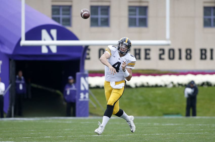 EVANSTON, ILLINOIS - OCTOBER 26: Nate Stanley #4 of the Iowa Hawkeyes throws a pass in the game against the Northwestern Wildcats during the first quarter at Ryan Field on October 26, 2019 in Evanston, Illinois. (Photo by Justin Casterline/Getty Images)