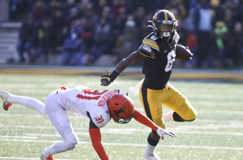 IOWA CITY, IOWA- NOVEMBER 23: Wide receiver Ihmir Smith-Marsette #6 of the Iowa Hawkeyes rushes up field during the first half past defensive back Devon Witherspoon #31 of the Illinois Fighting Illini on November 23, 2019 at Kinnick Stadium in Iowa City, Iowa. (Photo by Matthew Holst/Getty Images)