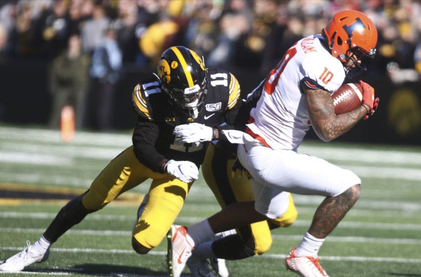 IOWA CITY, IOWA- NOVEMBER 23: Defensive back Michael Ojemudia #11 of the Iowa Hawkeyes makes a tackle during the first half on tight end Justice Williams #10 of the Illinois Fighting Illini on November 23, 2019 at Kinnick Stadium in Iowa City, Iowa. (Photo by Matthew Holst/Getty Images)