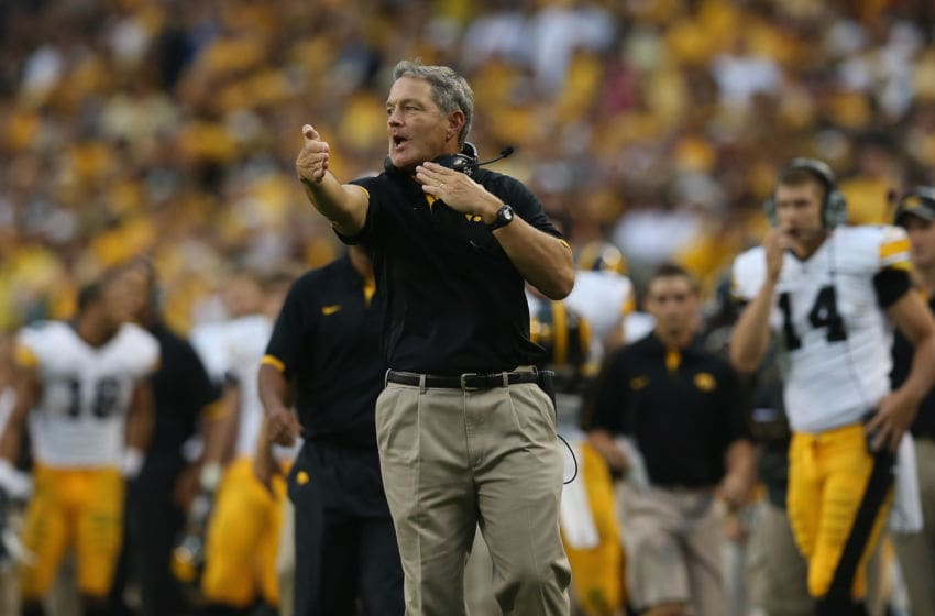CHICAGO, IL - SEPTEMBER 01: Head coach Kirk Ferentz of the Iowa Hawkeyes gives instructions to his team during a game against the Northern Illinois Huskies at Soldier Field on September 1, 2012 in Chicago, Illinois. Iowa defeated Northern Illinois 18-17. (Photo by Jonathan Daniel/Getty Images)