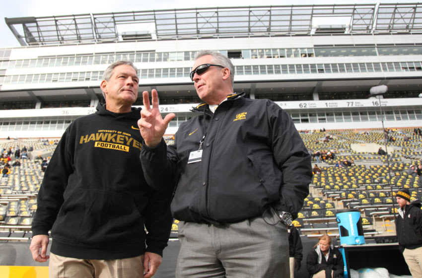 IOWA CITY, IA - OCTOBER 26: Head coach Kirk Ferentz of the Iowa Hawkeyes visits with athletic director Gary Barta prior to the match-up against the Northwestern Wildcats on October 26, 2013 at Kinnick Stadium in Iowa City, Iowa. (Photo by Matthew Holst/Getty Images)