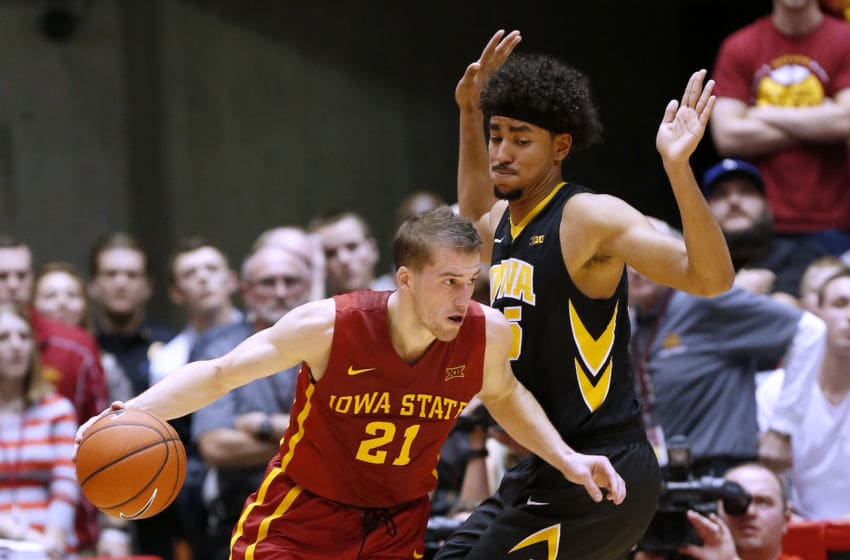 AMES, IA - DECEMBER 10: Matt Thomas #21 of the Iowa State Cyclones drives the ball past Dom Uhl #25 of the Iowa Hawkeyes in the second half of play at Hilton Coliseum on December 10, 2015 in Ames, Iowa. Iowa State defeated Iowa 83-82. (Photo by David Purdy/Getty Images)
