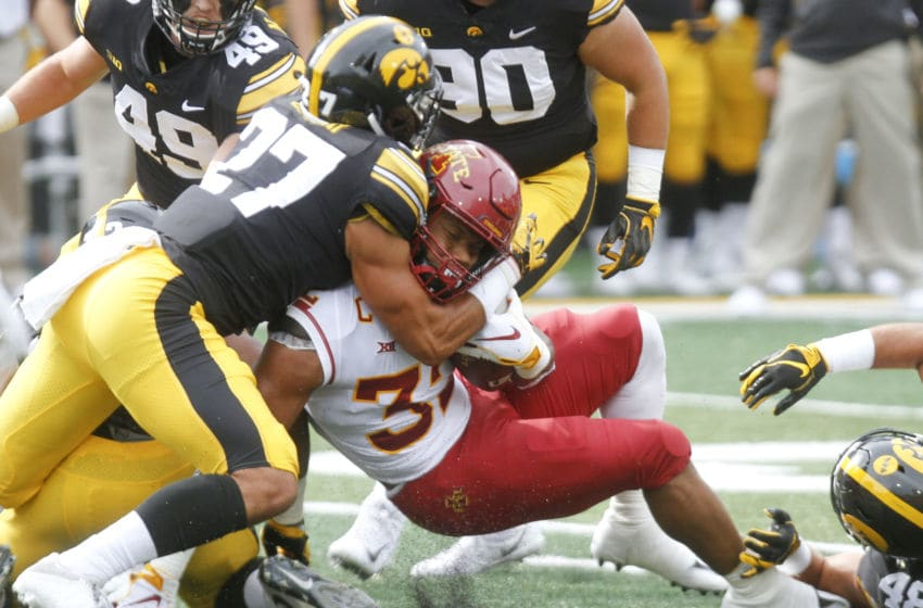 IOWA CITY, IOWA- SEPTEMBER 08: Runningback David Montgomery #32 of the Iowa State Cyclones is brought down during the first half by defensive back Amani Hooker #27of the Iowa Hawkeyes on September 8, 2018 at Kinnick Stadium, in Iowa City, Iowa. (Photo by Matthew Holst/Getty Images)
