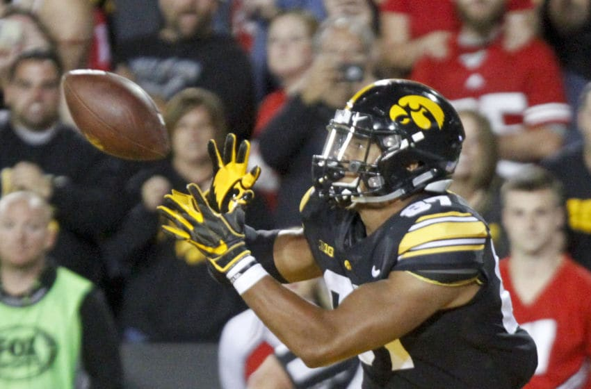 IOWA CITY, IOWA- SEPTEMBER 22: Tight end Noah Fant #87 of the Iowa Hawkeyes catches a touchdown pass during the first half against the Wisconsin Badgers on September 22, 2018 at Kinnick Stadium, in Iowa City, Iowa. (Photo by Matthew Holst/Getty Images)