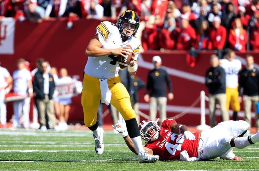 BLOOMINGTON, IN - OCTOBER 13: Nate Stanley #4 of the Iowa Hawkeyes runs with the ball against the Indiana Hossiers at Memorial Stadium on October 13, 2018 in Bloomington, Indiana. (Photo by Andy Lyons/Getty Images)