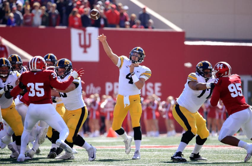 BLOOMINGTON, IN - OCTOBER 13: Nate Stanley #4 of the Iowa Hawkeyes throws the ball against the Indiana Hossiers at Memorial Stadium on October 13, 2018 in Bloomington, Indiana. (Photo by Andy Lyons/Getty Images)