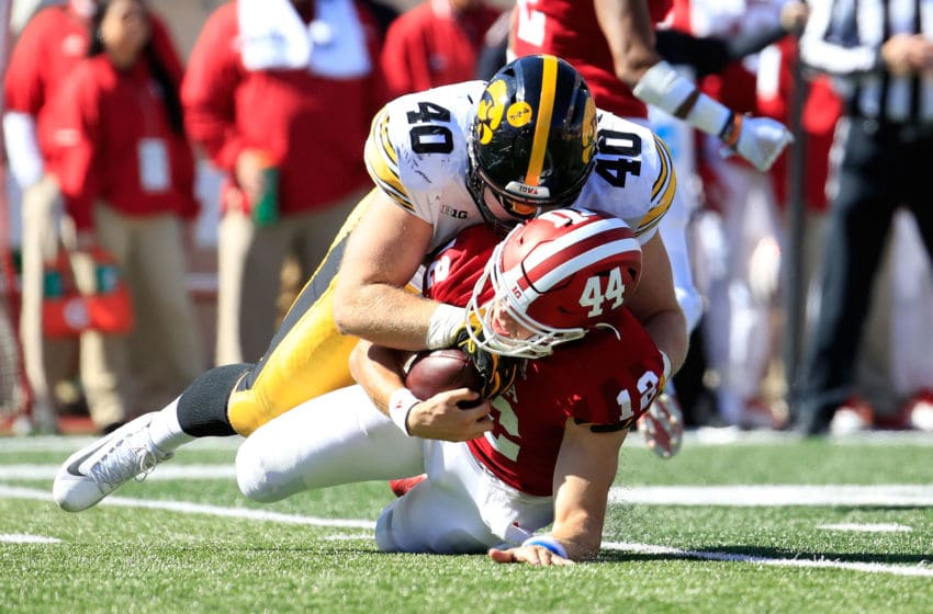 BLOOMINGTON, IN - OCTOBER 13: Peyton Ramsey #12 of the Indiana Hossiers is sacked by Parker Hesse #40 of the Iowa Hawkeyes at Memorial Stadium on October 13, 2018 in Bloomington, Indiana. (Photo by Andy Lyons/Getty Images)