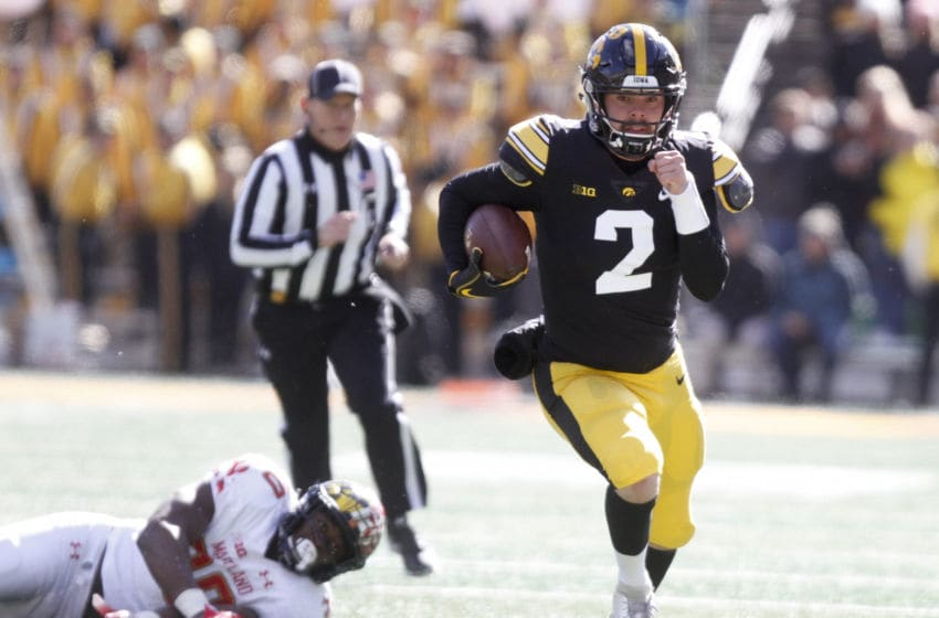 IOWA CITY, IOWA- OCTOBER 20: Quarterback Peyton Mansell #2 of the Iowa Hawkeyes runs up the field on a keeper during the second half in front of linebacker Durell Nchami #30 of the Maryland Terrapins on October 20, 2018 at Kinnick Stadium, in Iowa City, Iowa. (Photo by Matthew Holst/Getty Images)