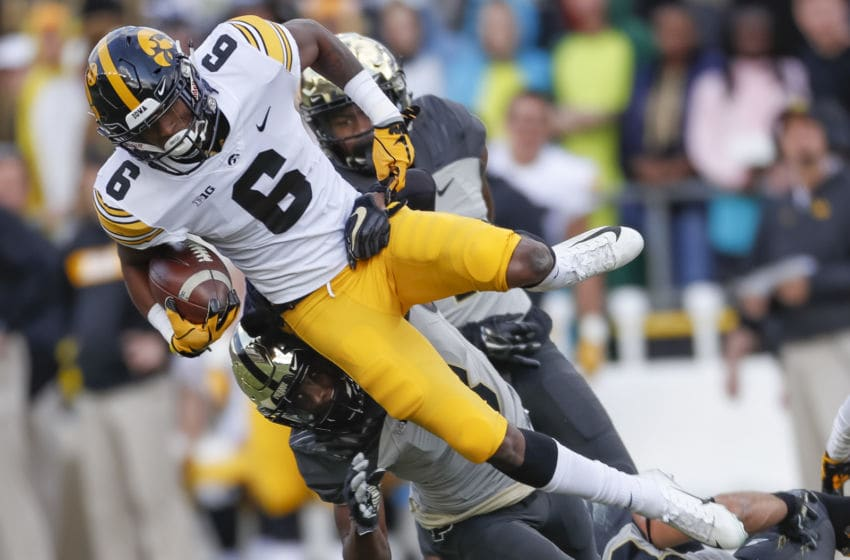 WEST LAFAYETTE, IN - NOVEMBER 03: Ihmir Smith-Marsette #6 of the Iowa Hawkeyes runs the ball and is tackled by Markell Jones #8 of the Purdue Boilermakers in the first half at Ross-Ade Stadium on November 3, 2018 in West Lafayette, Indiana. (Photo by Michael Hickey/Getty Images)