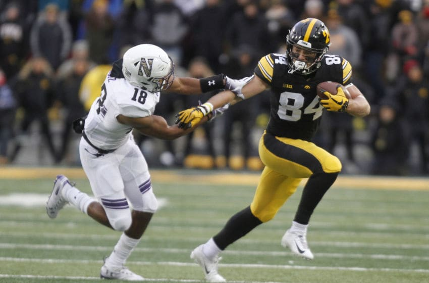 IOWA CITY, IOWA- NOVEMBER 10: Wide receiver Nick Easley #84 of the Iowa Hawkeyes runs up the field during the first half against defensive back Cameron Ruiz #18 of the Northwestern Wildcats on November 10, 2018 at Kinnick Stadium, in Iowa City, Iowa. (Photo by Matthew Holst/Getty Images)