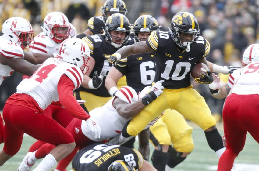 IOWA CITY, IOWA - NOVEMBER 23: Running back Mekhi Sargent #10 of the Iowa Hawkeyes is tackled during the first half by linebacker Mohamed Barry #7 of the Nebraska Cornhuskers on November 23, 2018 at Kinnick Stadium, in Iowa City, Iowa. (Photo by Matthew Holst/Getty Images)