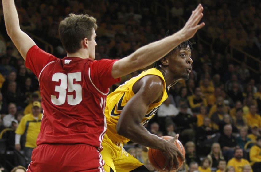 IOWA CITY, IOWA- NOVEMBER 30: Forward Tyler Cook #25 of the Iowa Hawkeyes drives down the court in the second half against forward Nate Reuvers #35 of the Wisconsin Badgers, on November 30, 2018 at Carver-Hawkeye Arena, in Iowa City, Iowa. (Photo by Matthew Holst/Getty Images)