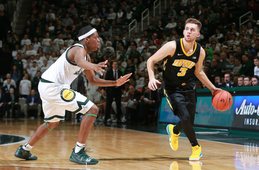 EAST LANSING, MI - DECEMBER 03: Jordan Bohannon #3 of the Iowa Hawkeyes handles the ball while defended by Cassius Winston #5 of the Michigan State Spartans in the second half at Breslin Center on December 3, 2018 in East Lansing, Michigan. (Photo by Rey Del Rio/Getty Images)