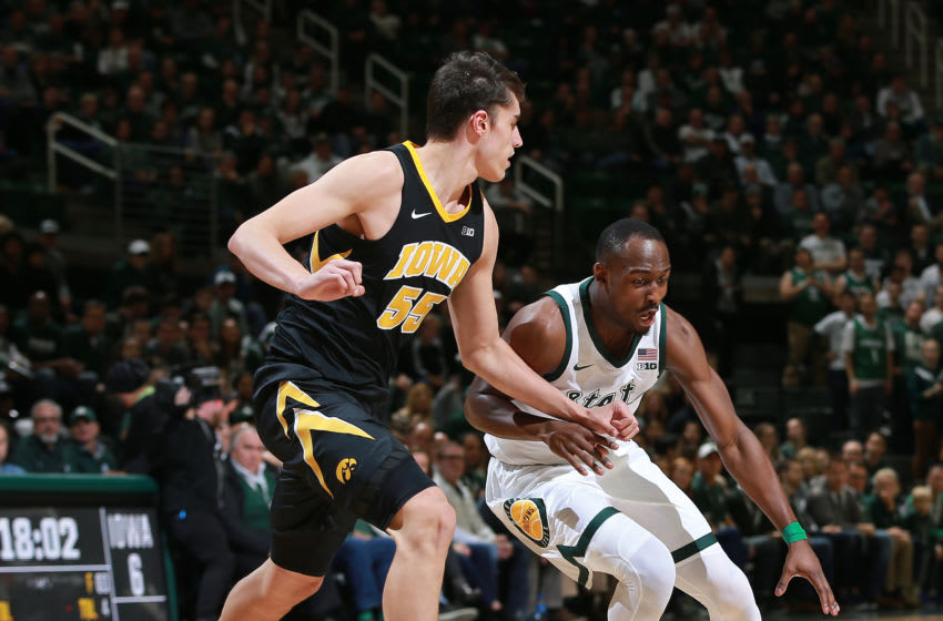 EAST LANSING, MI - DECEMBER 03: Joshua Langford #1 of the Michigan State Spartans drives to the basket while defended by Luka Garza #55 of the Iowa Hawkeyes in the first half at Breslin Center on December 3, 2018 in East Lansing, Michigan. (Photo by Rey Del Rio/Getty Images)