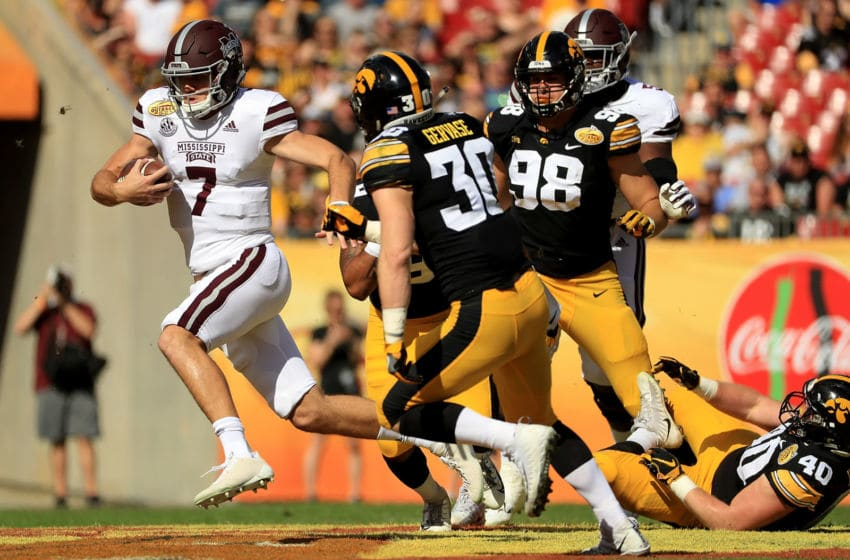 TAMPA, FL - JANUARY 01: Nick Fitzgerald #7 of the Mississippi State Bulldogs rushes during the 2019 Outback Bowl against the Iowa Hawkeyes at Raymond James Stadium on January 1, 2019 in Tampa, Florida. (Photo by Mike Ehrmann/Getty Images)