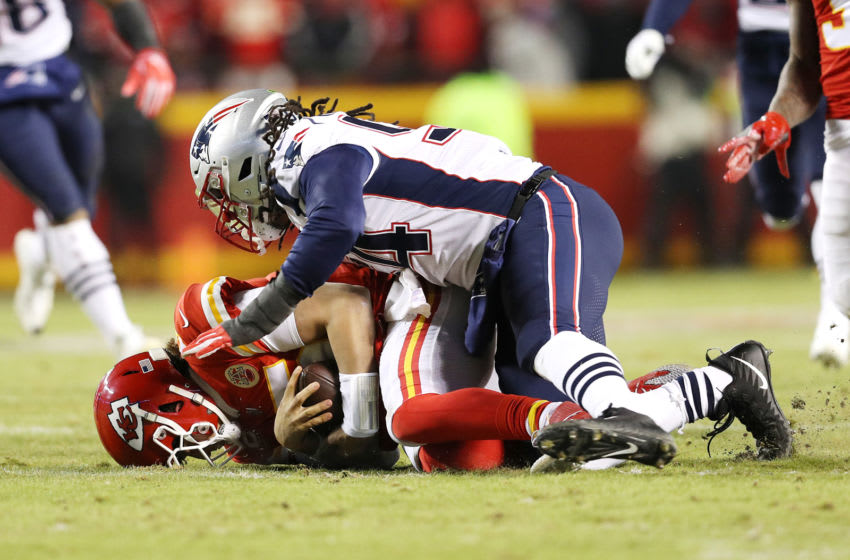 KANSAS CITY, MISSOURI - JANUARY 20: Patrick Mahomes #15 of the Kansas City Chiefs is tackled by Adrian Clayborn #94 of the New England Patriots in the first half during the AFC Championship Game at Arrowhead Stadium on January 20, 2019 in Kansas City, Missouri. (Photo by Patrick Smith/Getty Images)