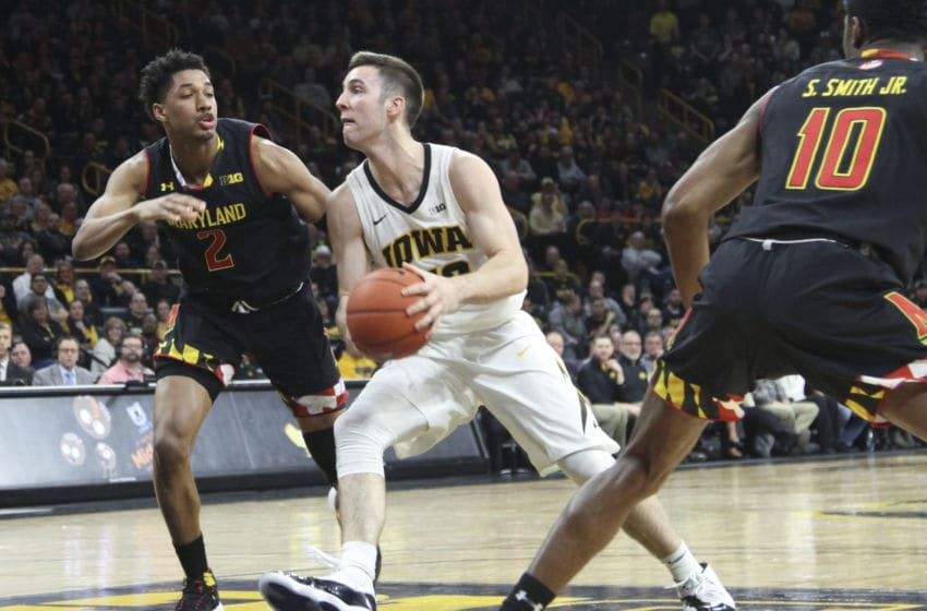 IOWA CITY, IOWA- FEBRUARY 19: Guard Connor McCaffery #30 of the Iowa Hawkeyes goes to the basket in the second half against guard Aaron Wiggins #2 of the Maryland Terrapins on February 19, 2019 at Carver-Hawkeye Arena, in Iowa City, Iowa. (Photo by Matthew Holst/Getty Images)