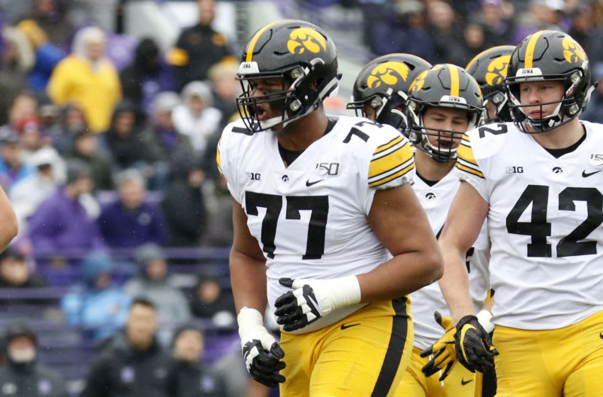EVANSTON, ILLINOIS - OCTOBER 26: Alaric Jackson #77 of the Iowa Hawkeyes on the field in the game against the Northwestern Wildcats at Ryan Field on October 26, 2019 in Evanston, Illinois. (Photo by Justin Casterline/Getty Images)
