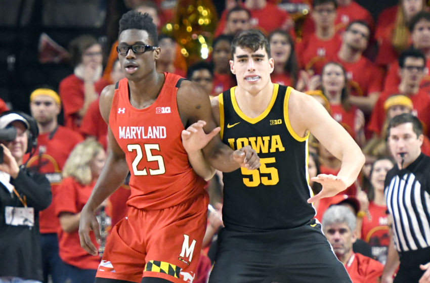 COLLEGE PARK, MARYLAND - JANUARY 30: Jalen Smith #25 of the Maryland Terrapins and Luka Garza #55 of the Iowa Hawkeyes fight for postion during a college basketball game against the Maryland Terrapins at Xfinity Center on January 30, 2020 in College Park, Maryland. (Photo by Mitchell Layton/Getty Images)