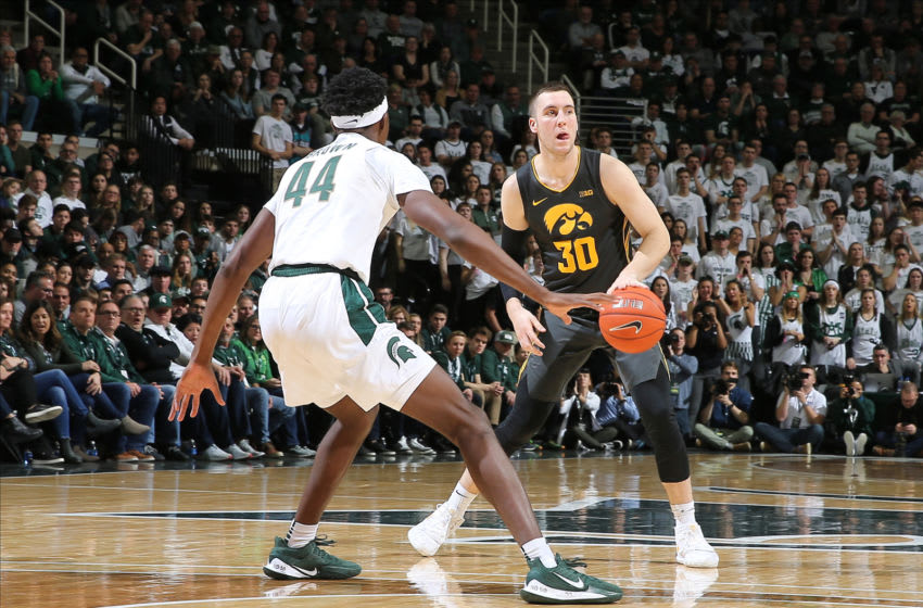 EAST LANSING, MI - FEBRUARY 25: Connor McCaffery #30 of the Iowa Hawkeyes handles the ball while defended by Gabe Brown #44 of the Michigan State Spartans in the second half of the game at the Breslin Center on February 25, 2020 in East Lansing, Michigan. (Photo by Rey Del Rio/Getty Images)