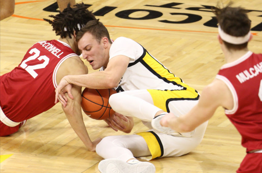 IOWA CITY, IOWA- FEBRUARY 10: Forward Jack Nunge #2 of the Iowa Basketball team battles for a loose ball during the first half against guard Caleb McConnell #22 of the Rutgers Scarlet Knights at Carver-Hawkeye Arena on February 10, 2021 in Iowa City, Iowa. (Photo by Matthew Holst/Getty Images)