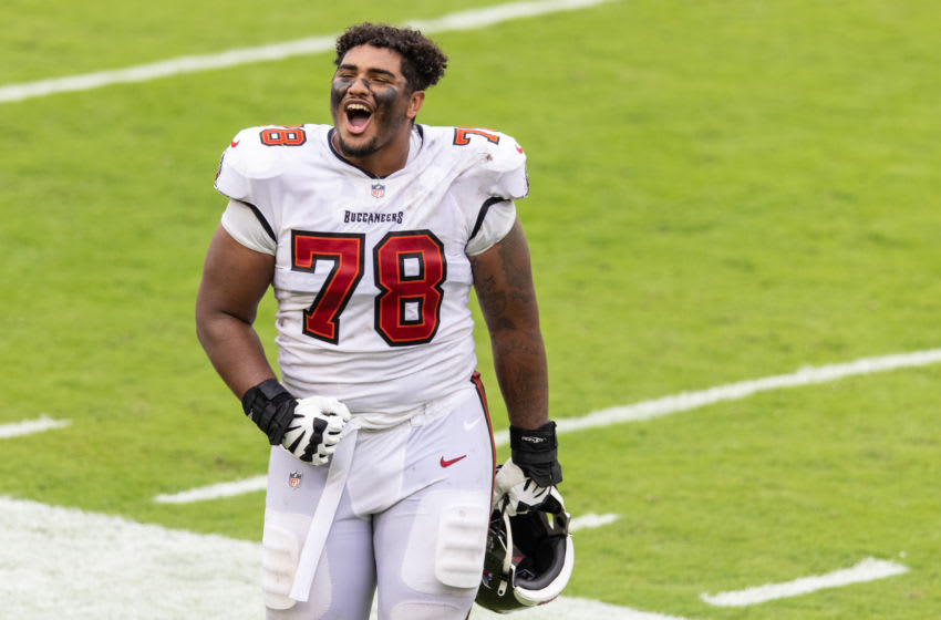 TAMPA, FLORIDA - OCTOBER 04: Tristan Wirfs #78 of the Tampa Bay Buccaneers celebrates after a game against the Los Angeles Chargers at Raymond James Stadium on October 04, 2020 in Tampa, Florida. Wirfs played for Iowa Football and was a key member for the Hawkeyes. (Photo by James Gilbert/Getty Images)