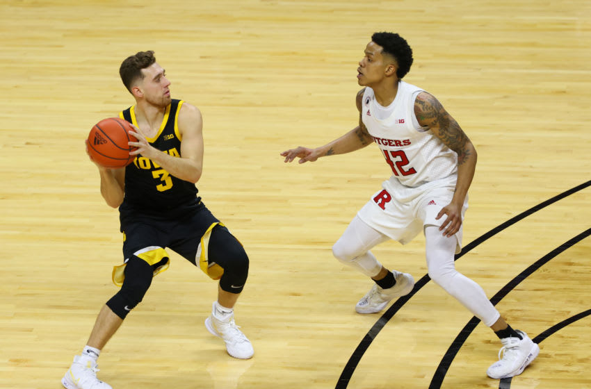 PISCATAWAY, NJ - JANUARY 02: Jordan Bohannon #3 of the Iowa Hawkeyes in action against Jacob Young #42 of the Rutgers Scarlet Knights during a college basketball game at Rutgers Athletic Center on January 2, 2021 in Piscataway, New Jersey. Iowa defeated Rutgers 77-75. (Photo by Rich Schultz/Getty Images)