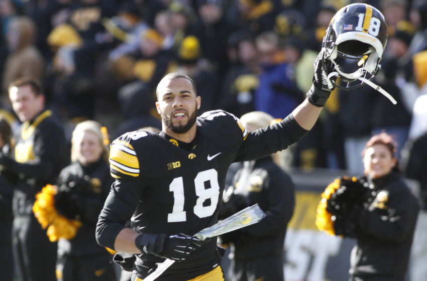 IOWA CITY, IA- NOVEMBER 23: Defensive back Micah Hyde #18 of the Iowa Hawkeyes waves to the crowd during senior day ceremonies before their match-up against the Nebraska Cornhuskers on November 23, 2012 at Kinnick Stadium in Iowa City, Iowa. Nebraska defeated Iowa 13-7. (Photo by Matthew Holst/Getty Images)