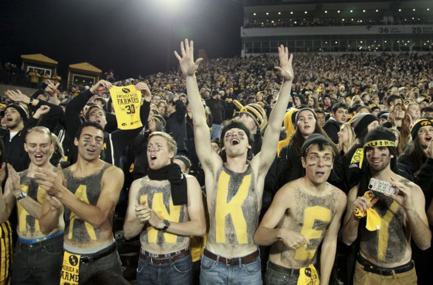 IOWA CITY, IA - NOVEMBER 14: Fans of the Iowa Hawkeyes celebrate after the match-up against the Minnesota Gophers on November 14, 2015 at Kinnick Stadium, in Iowa City, Iowa. (Photo by Matthew Holst/Getty Images)