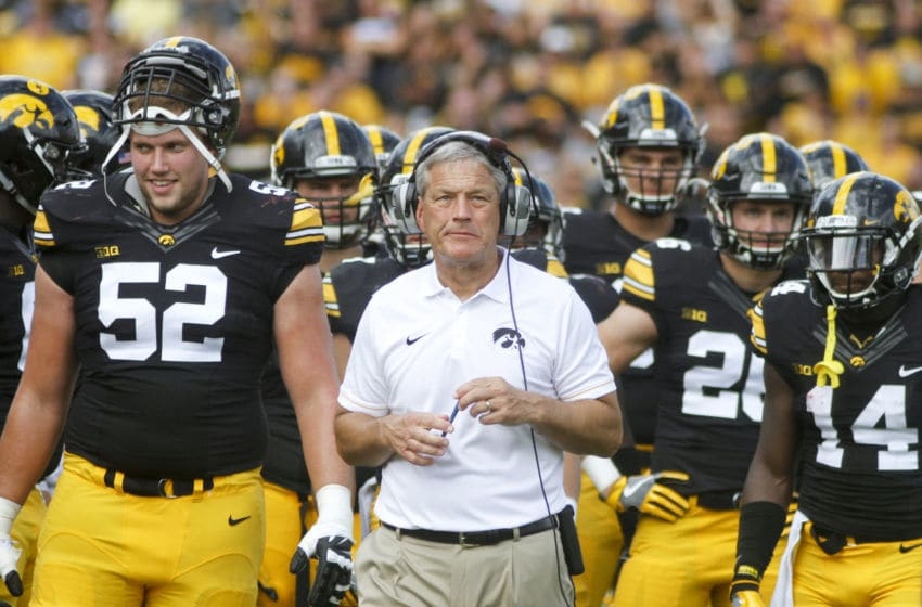 IOWA CITY, IOWA- SEPTEMBER 3: Head coach Kirk Ferentz of the Iowa Hawkeyes waits with his team during a play review in the second quarter against the Miami (OH) RedHawks on September 3, 2016 at Kinnick Stadium in Iowa City, Iowa. (Photo by Matthew Holst/Getty Images)