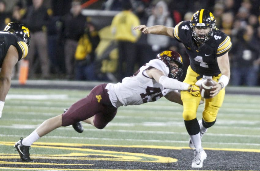 IOWA CITY, IOWA- OCTOBER 28: Quarterback Nathan Stanley #4 of the Iowa Hawkeyes rushes up field during the second quarter against linebacker Carter Coughlin #45 of the Minnesota Golden Gophers on October 28, 2017 at Kinnick Stadium in Iowa City, Iowa. (Photo by Matthew Holst/Getty Images)