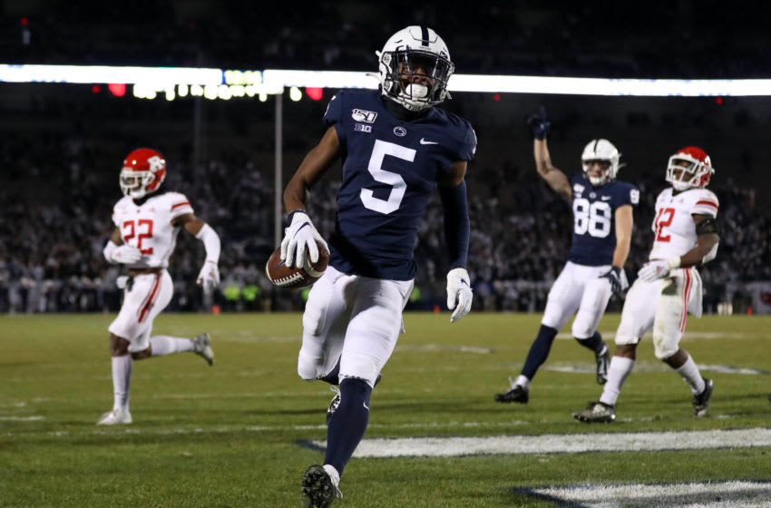 Nov 30, 2019; University Park, PA, USA; Penn State Nittany Lions wide receiver Jahan Dotson (5) runs the ball into the end zone for a touchdown during the fourth quarter against the Rutgers Scarlet Knights at Beaver Stadium. Penn State defeated Rutgers 27-6. Mandatory Credit: Matthew O'Haren-USA TODAY Sports