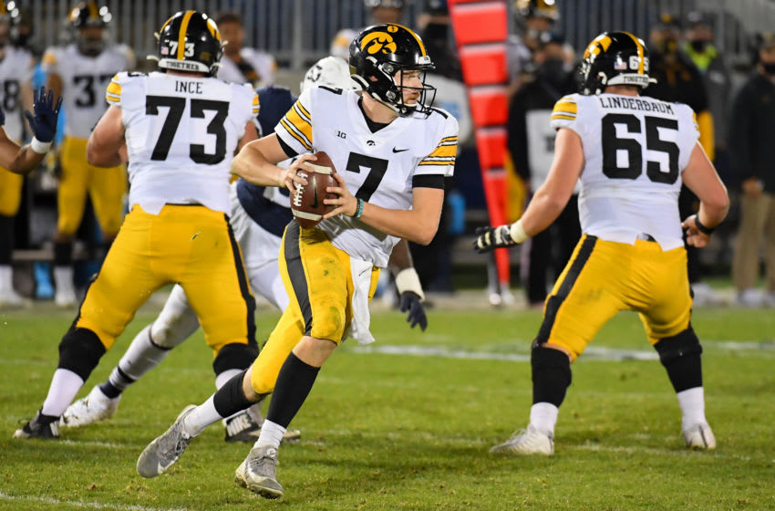 Nov 21, 2020; University Park, Pennsylvania, USA; Iowa Hawkeyes quarterback Spencer Petras (7) runs with the ball against the Penn State Nittany Lions during the fourth quarter at Beaver Stadium. Mandatory Credit: Rich Barnes-USA TODAY Sports