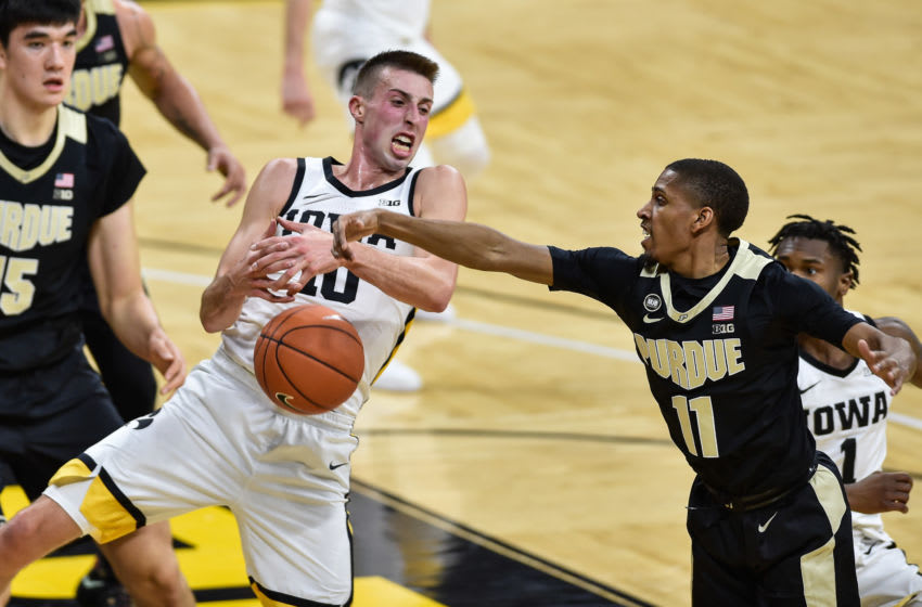 Dec 22, 2020; Iowa City, Iowa, USA; Iowa Hawkeyes guard Joe Wieskamp (10) and Purdue Boilermakers guard Isaiah Thompson (11) battle for a loose ball during the first half at Carver-Hawkeye Arena. Mandatory Credit: Jeffrey Becker-USA TODAY Sports