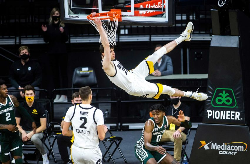 Iowa forward Patrick McCaffery (22) dunks the ball as Michigan State forward Aaron Henry (0) defends during a NCAA Big Ten Conference men's basketball game, Tuesday, Feb. 2, 2021, at Carver-Hawkeye Arena in Iowa City, Iowa. 210202 Mi St Iowa Mbb 028 Jpg