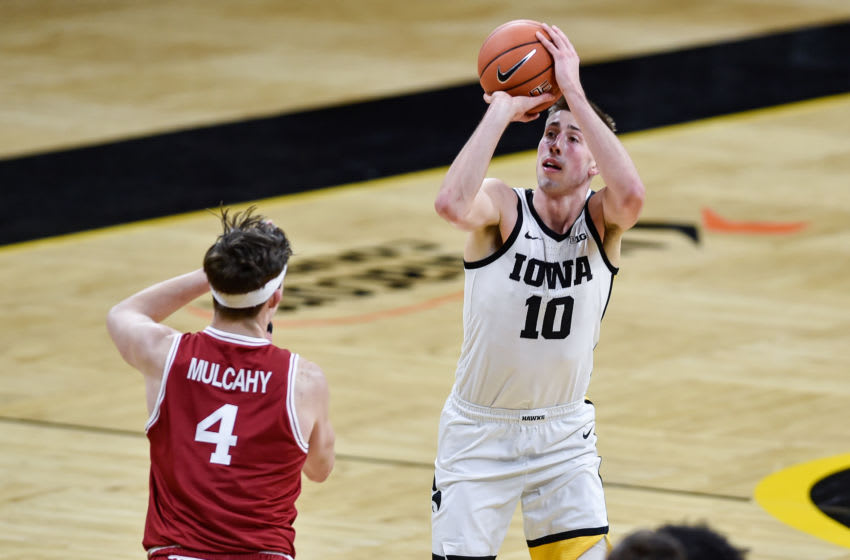 Feb 10, 2021; Iowa City, Iowa, USA; Iowa Hawkeyes guard Joe Wieskamp (10) shoots a three-point basket as Rutgers Scarlet Knights guard Paul Mulcahy (4) defends during the second half at Carver-Hawkeye Arena. Mandatory Credit: Jeffrey Becker-USA TODAY Sports