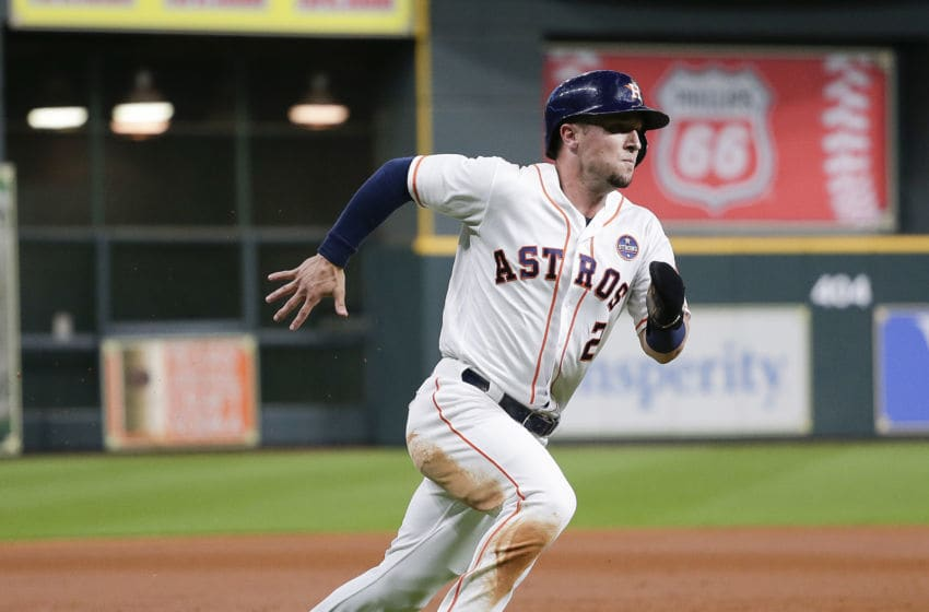 HOUSTON, TX - SEPTEMBER 04: Alex Bregman #2 of the Houston Astros scores in the first inning on a single by Tyler White #13 against the Minnesota Twins at Minute Maid Park on September 4, 2018 in Houston, Texas. (Photo by Bob Levey/Getty Images)
