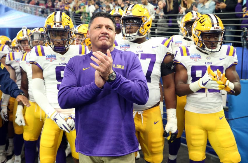 GLENDALE, ARIZONA - JANUARY 01: Head coach Ed Orgeron of the LSU Tigers waits to take the field before the PlayStation Fiesta Bowl between LSU and Central Florida at State Farm Stadium on January 01, 2019 in Glendale, Arizona. (Photo by Christian Petersen/Getty Images)