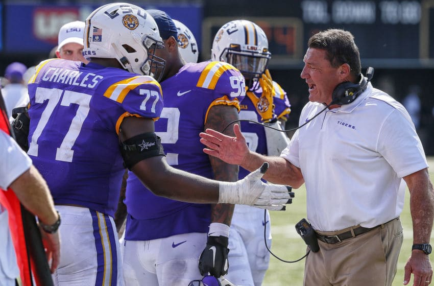 NASHVILLE, TENNESSEE - SEPTEMBER 21: Head coach Ed Orgeron of the LSU Tigers high fives Saahdiq Charles #77 during the second half of a game against the Vanderbilt Commodores at Vanderbilt Stadium on September 21, 2019 in Nashville, Tennessee. (Photo by Frederick Breedon/Getty Images)