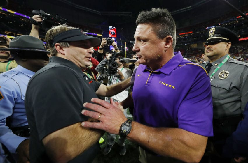 ATLANTA, GEORGIA - DECEMBER 07: Head coach Ed Orgeron of the LSU Tigers (R) greets head coach Kirby Smart of the Georgia Bulldogs after winning the SEC Championship game 37-10 at Mercedes-Benz Stadium on December 07, 2019 in Atlanta, Georgia. (Photo by Kevin C. Cox/Getty Images)