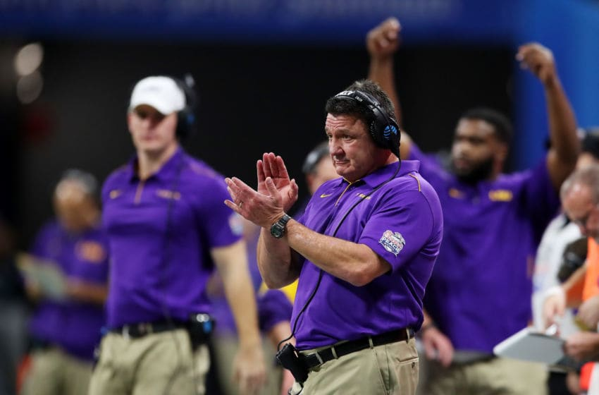 ATLANTA, GEORGIA - DECEMBER 28: Head coach Ed Orgeron of the LSU Tigers looks on from the sidelines during the game against the Oklahoma Sooners in the Chick-fil-A Peach Bowl at Mercedes-Benz Stadium on December 28, 2019 in Atlanta, Georgia. (Photo by Gregory Shamus/Getty Images)