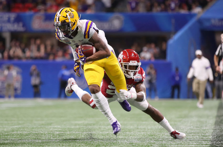ATLANTA, GEORGIA - DECEMBER 28: Ja'Marr Chase #1 of the LSU Tigers tries to break the tackle of Justin Broiles #25 of the Oklahoma Sooners during the College Football Playoff Semifinal in the Chick-fil-A Peach Bowl at Mercedes-Benz Stadium on December 28, 2019 in Atlanta, Georgia. (Photo by Gregory Shamus/Getty Images)